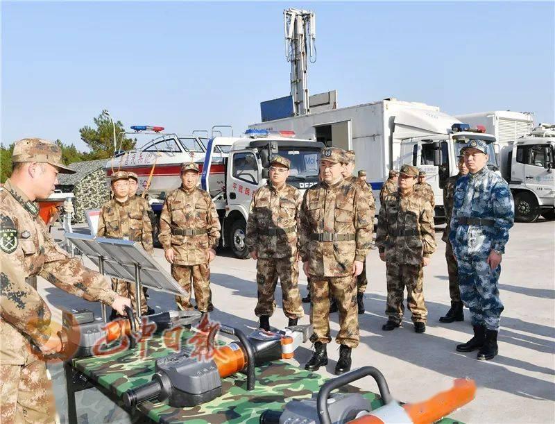 罗增斌等市领导参加军事日活动